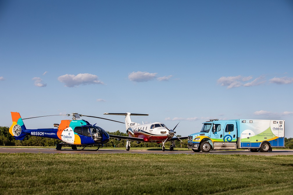 photo of childrens helicopter plane and ambulance