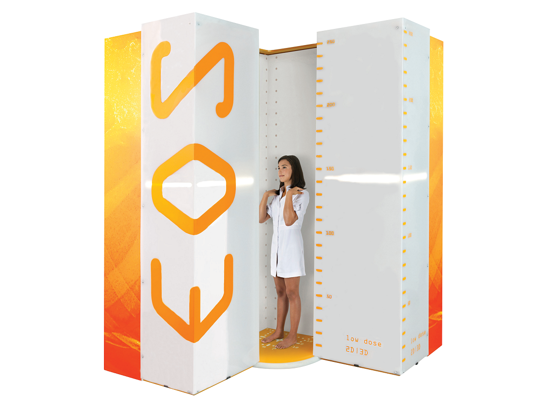 image of woman standing inside eos machine