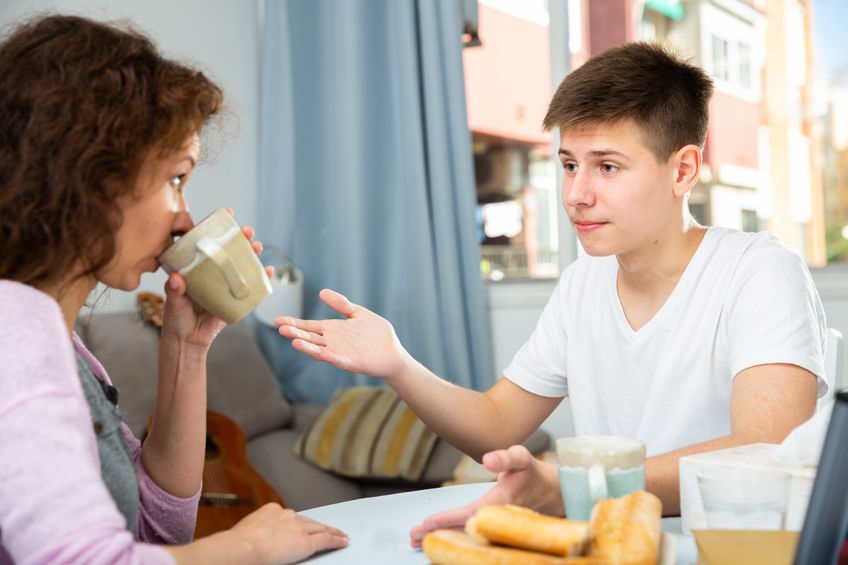 Teenage son and mom
