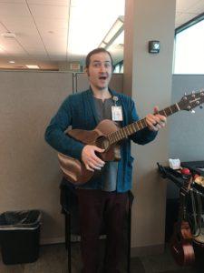 photo of caleb holding guitar